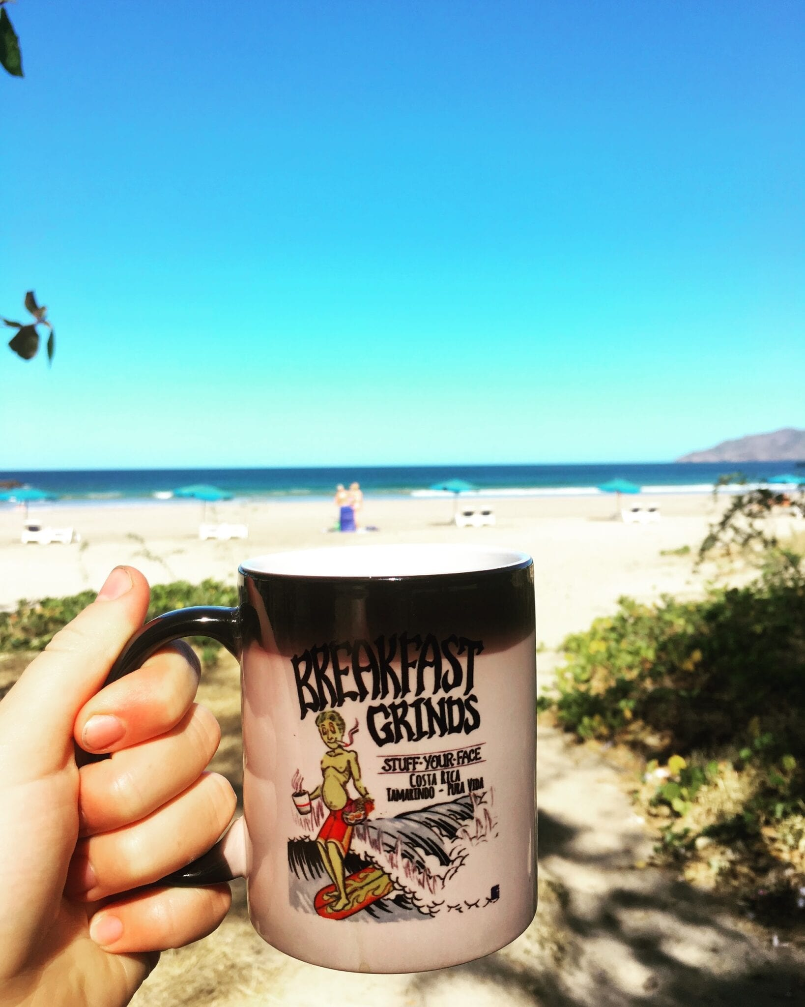 Morning cup of coffee on the beach.