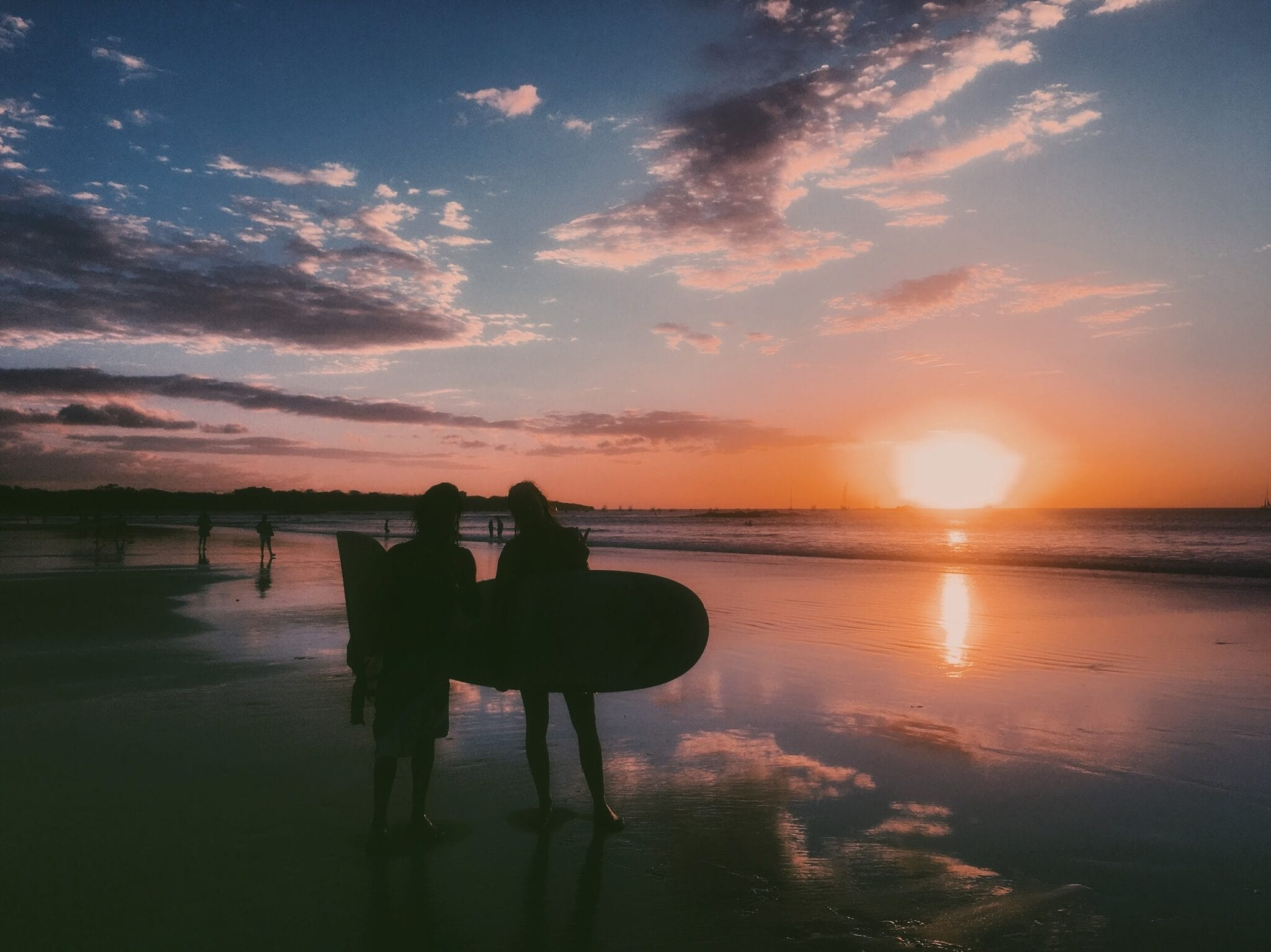 Sunset surfing at Playa Tamarindo.
